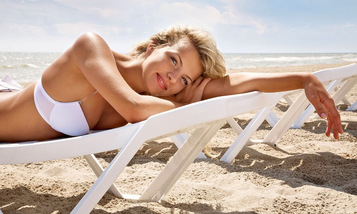 South Beach Tanning - Multiple Locations: $35 for Custom Spray and UV Tans at South Beach Tanning ($135 Value)