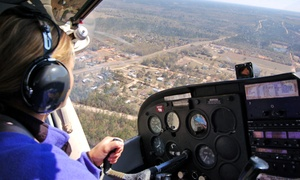 Aptis Aviation: 30-Minute Flight Experience or Top Gun Flying Instruction Package at Aptis Aviation (Up to 49% Off)