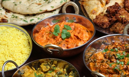 TwoCourse Indian Meal with Sides and Drinks for Two or Four at Romna Restaurant