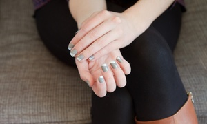TJ's Haircutters and Tanning: Spa Mani-Pedi or Gel Manicure at TJ's Haircutters and Tanning (Up to 51% Off)