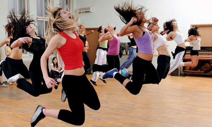 Here And There - Aventura: Four Zumba or Rebolaxé Classes at Here and There (70% Off)