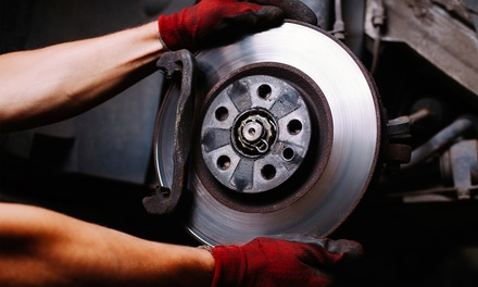 Front or Rear Brake Pad Installation or Both with Tire Rotation at Grease Monkey (Up to 50% Off)
