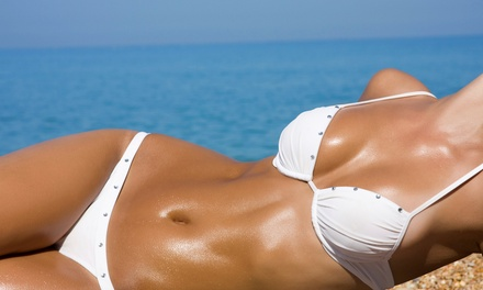 Mystic or Norvell Spray Tan or Month of Unlimited Bed Tanning or Red-Light Therapy at Island Tan (Up to 71% Off)