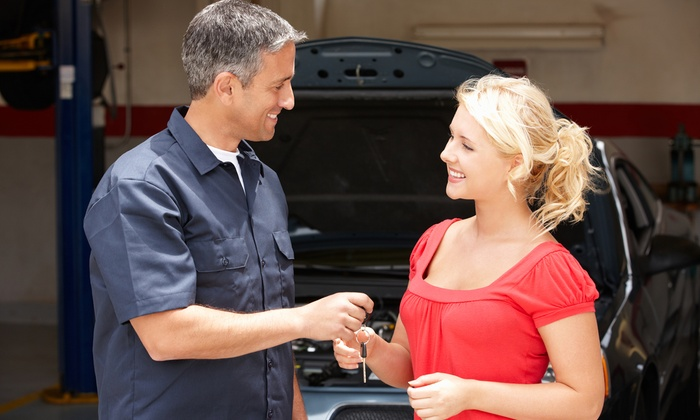 Auto Care Special - Orange County: $33 for Three Oil Changes, Two Tire Rotations, Engine-Light Check, and Inspections from Auto Care Special ($199 Value)