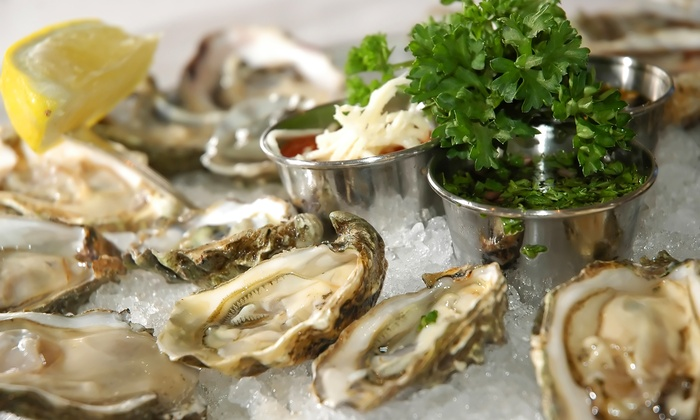 Shuck Dat Oyster Bar - Tavares: $18 for $30 Worth of Oysters and Cajun Food for Dinner for Two or More at Shuck Dat Oyster Bar