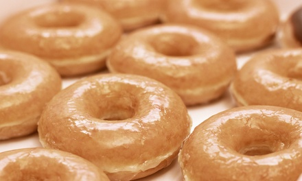 $12 for Two Groupons, Each Good for $10 Worth of Donuts at Tasty Daylight Donuts ($20 Total Value)