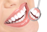 Check-Up, Scale and Polish for One or Two, or Laser Teeth Whitening with Fluoride Application at Delma Medical Center*