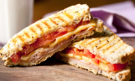 Paninis, Wraps, and Coffee Drinks at Cafe Buzzz (Up to 50% Off). Three Options Available.