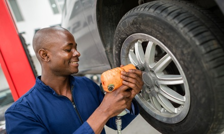 Tire Rotation with Optional Diagnostic Test for All Four Wheels at Pit Stop Mechanic & Collision (Up to 36% Off)