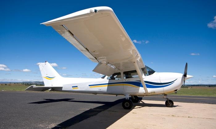 Burlington Aviation - 12, Burlington: $135 for a 60-Minute Flight Lesson Plus Video from Burlington Aviation ($250 Value)