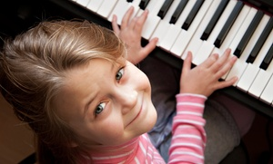 Rock It Out! Music School: Two, Four, or Six 30-Minute Piano Lessons at Rock It Out! Music School (Up to 57% Off)