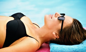 Darque Tan: Five UV Tans in Five Levels of Beds or One VersaSpa or Norvell Spray Tan at Darque Tan (Up to 87% Off)