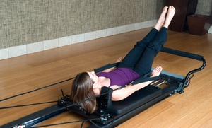 Club Pilates Tucson: Four or Eight Reformer Pilates Classes at Club Pilates (Up to 42% Off)
