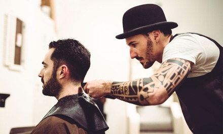 1 or 2 Men's Haircuts with Shampoo from Mae Bovenzi at Salon De Marcus (Up to 76% Off). Two Options Available.