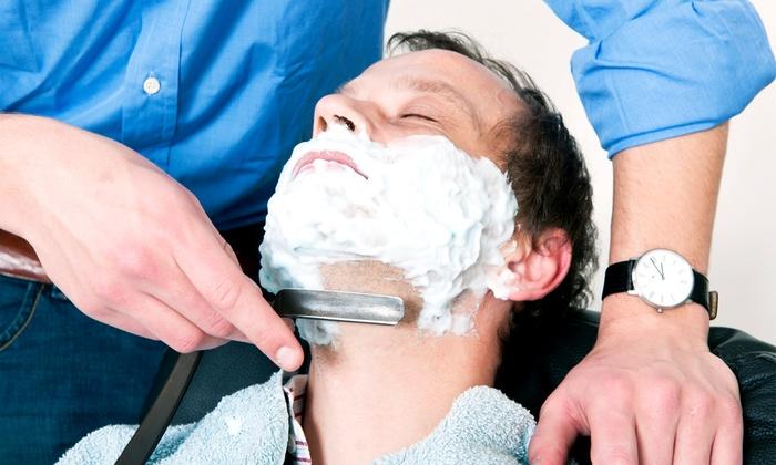 Upper Echelon Barbershop - Largo: $12 for a Men's Haircut with a Shave at Upper Echelon Barbershop ($25 Value)