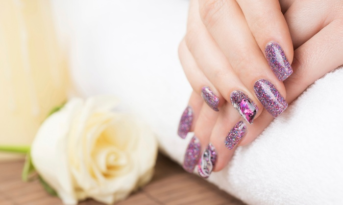 Exotic Nails & Spa - East Watertown: One or Three Shellac Manicures with Paraffin Treatments at Exotic Nails & Spa (Up to 52% Off)