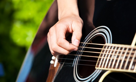 $49 for Four Private Guitar Lessons with Free Lesson eBook at American Guitar Academy ($129.95 Value)
