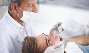 Champion Dentistry: One or Two Cleanings, X-Ray, and Exam at Champion Dentistry (Up to 90% Off)