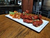 Up to 50% Off on American Cuisine at Landon's East meets West