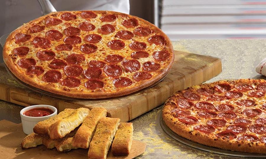 Dominos Pizza: Pizza familiar de 2 ingredientes o Dominator de 4 ingredientes + Breadsticks en Domino's Pizza