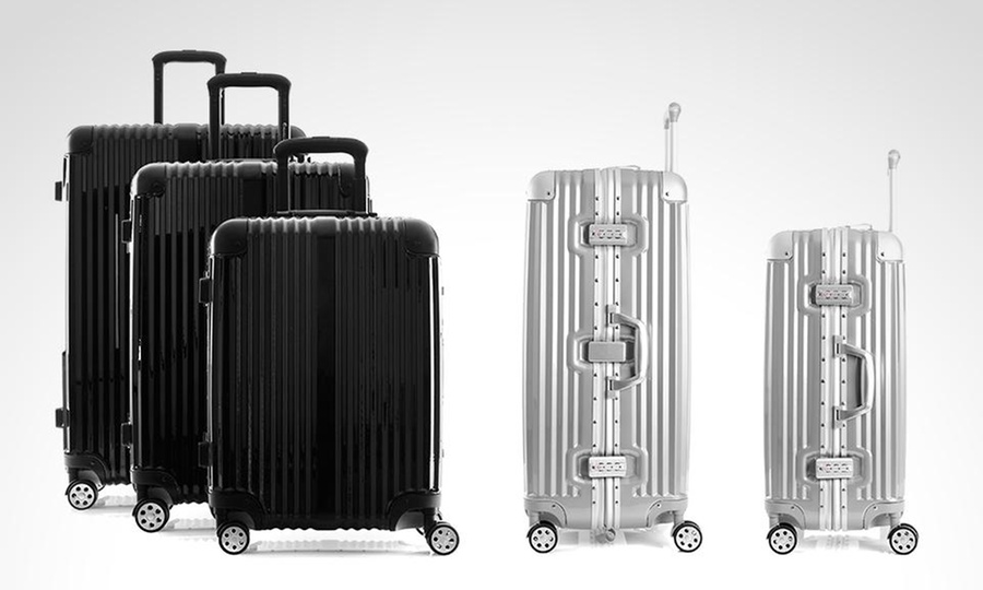 Groupon Shopping: 3 maletas Travel Collection Hardside Elite Alum en color a elección. Incluye despacho