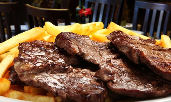 Parrillada Chilena El Pollo al Caño - Parrillada Chilena El Pollo al Caño: $13.900 en vez de $31.780 por parrillada del campo para cuatro con papas fritas + 4 pisco sour + 6 empanadas de queso en Parrillada Chilena El Pollo al Caño