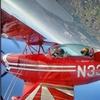 1-hour Aerobatic Bi-plane Sightseeing Flight and Demonstration