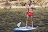 Viajes al atardecer de aventura de surf de remo