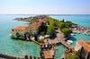 Sirmione: Tour Privato in Barca di 1 Ora e Mezza dell'Isola del Garda
