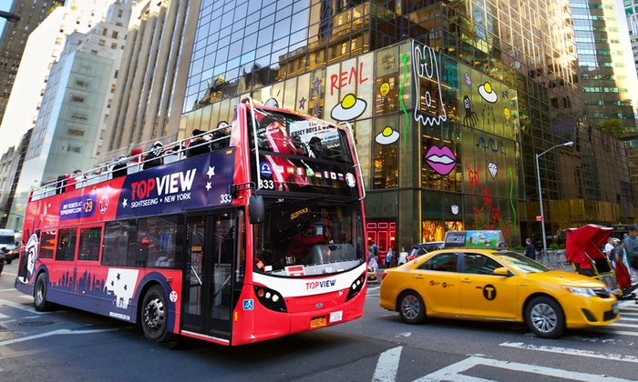 CitySights NY operates double-decker buses with top-deck-only seating to give tourists the best views of New York City. Instead of reserved seating on one bus, the company has designated stops where you wait for a CitySights bus with available seats.