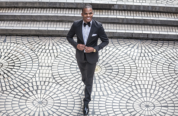 suit style fit man walking on tiled surface