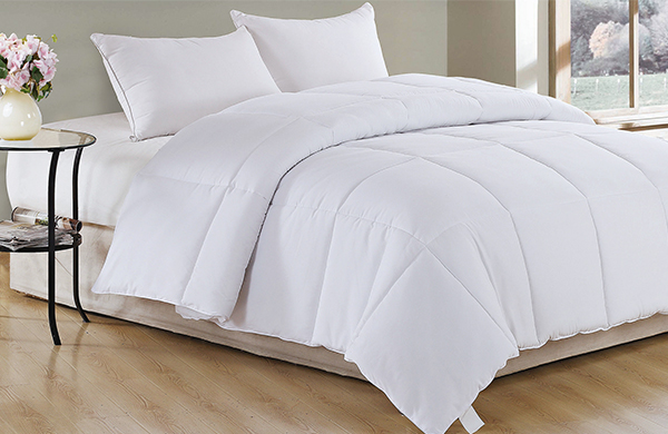 white down comforter duvet bedding in bedroom