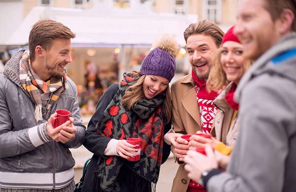 Group of Adult Friends Attend Outdoor Winter Festival in Daytime