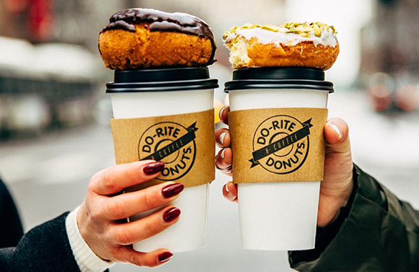 Do-Rite Donuts coffee cups with donuts on top