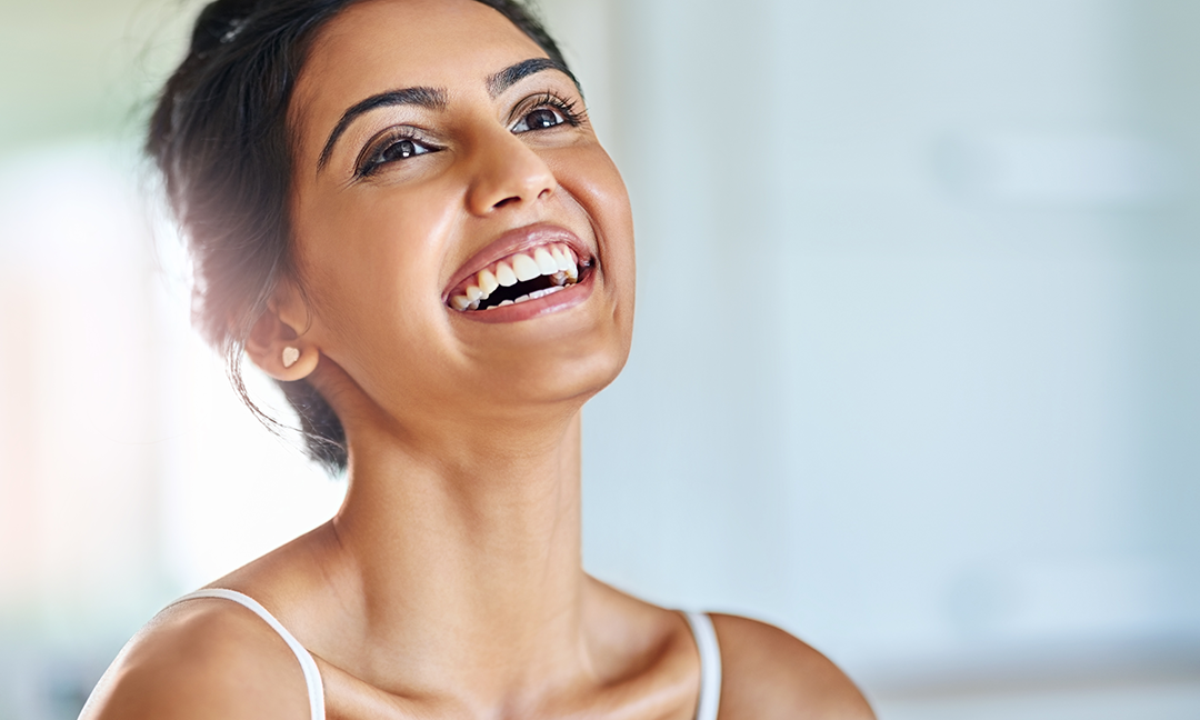 woman-with-long-neck-looking-up-and-smiling