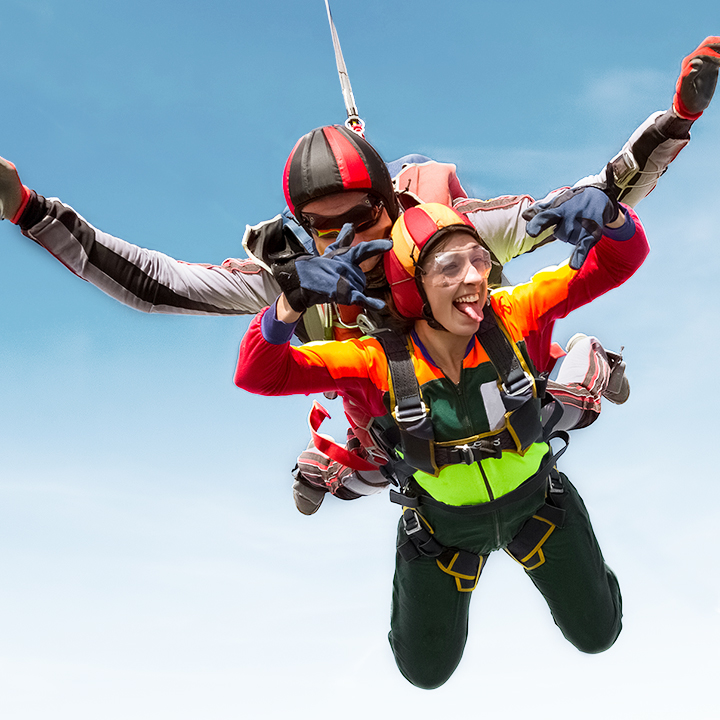 People doing tandem skydiving