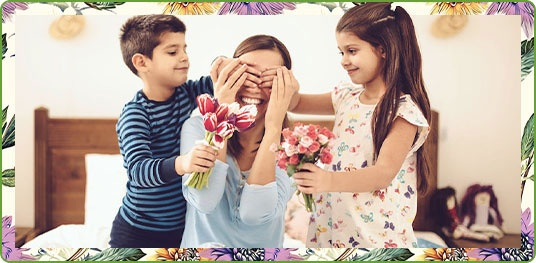 Kids surprising mom with flowers & gifts
