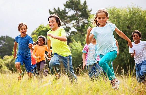 group of young children running and laughing in a field - Picture Of Little Kids