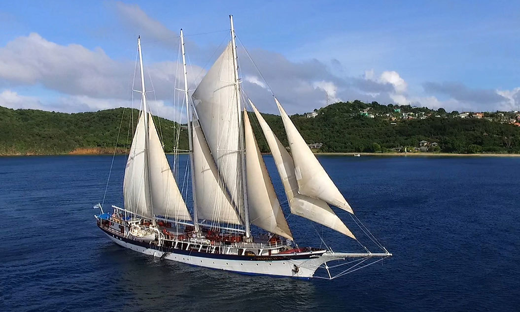 Tall ship cruise ship sailing on blue waters