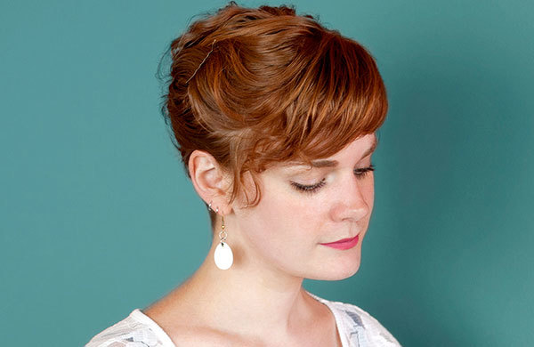 Red headed woman with wavy short haircut