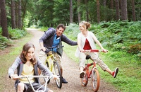 Parents and kids on bikes