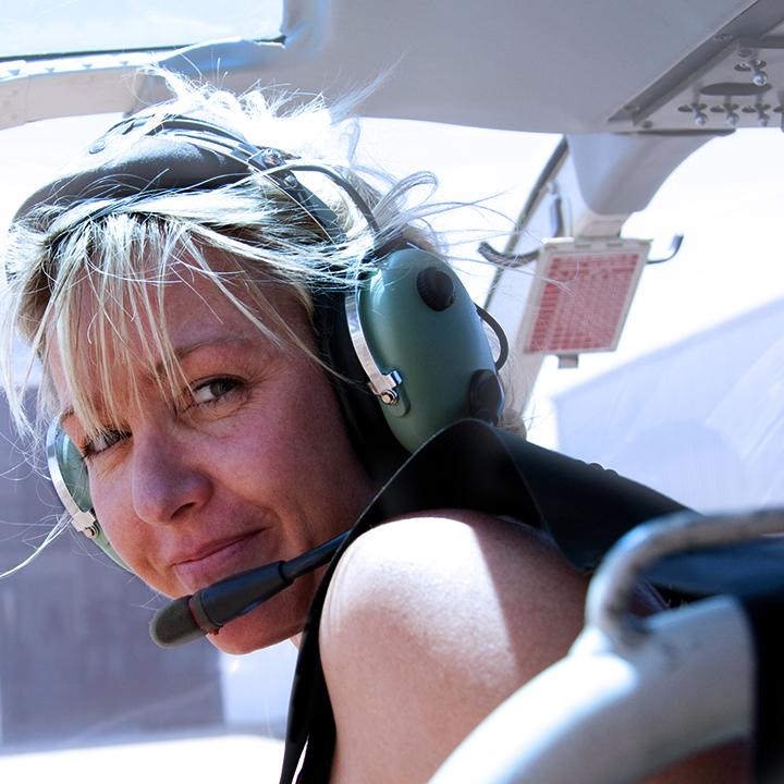 Woman enjoying a helicopter ride
