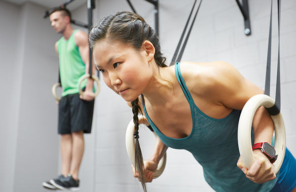 brunette-woman-doing-crossfit-weight-resistance-exercise_jpg-600x390 (600×390)