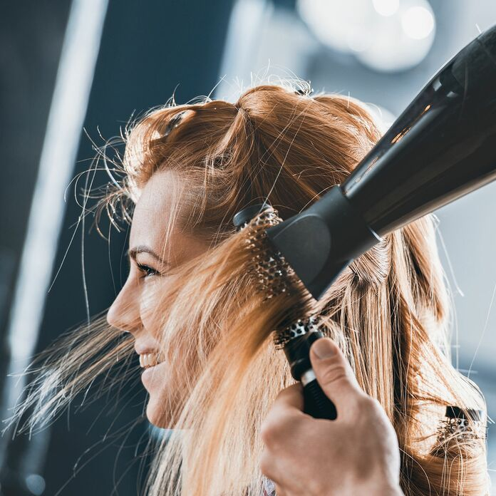 Woman getting her hair blow dried
