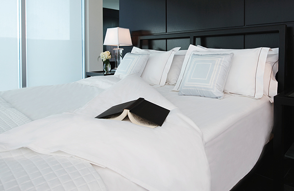 White comforter and bedding in luxurious bedroom