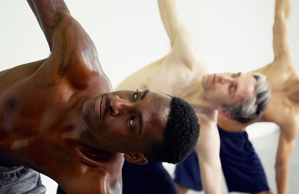 Men doing hot yoga