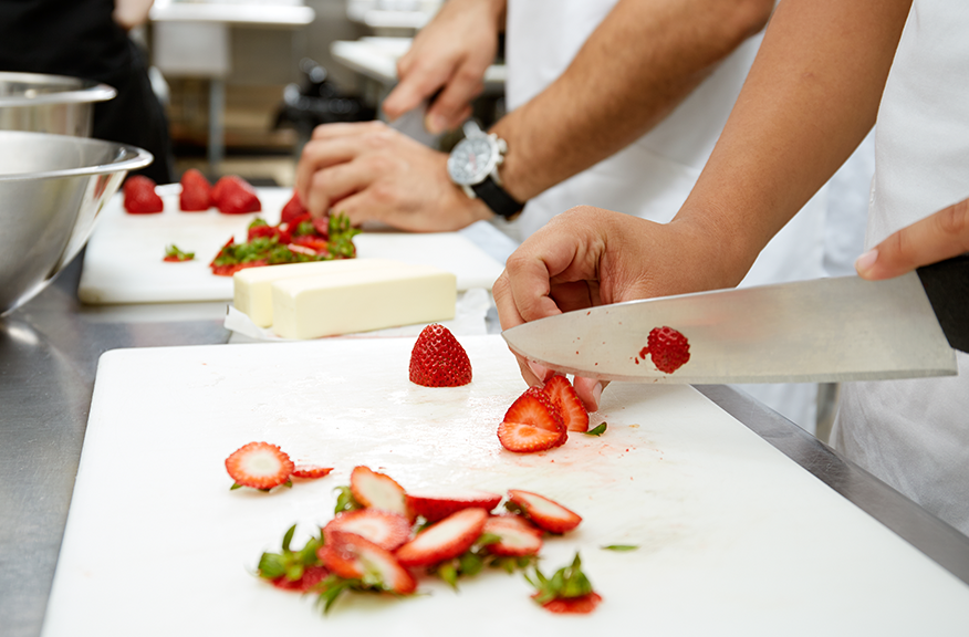 Chefs cutting strawberries incorrectly