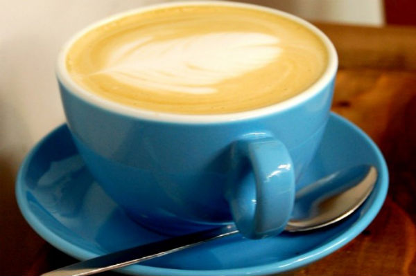 Cappucino in a blue coffee mug