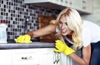 woman deep cleaning kitchen