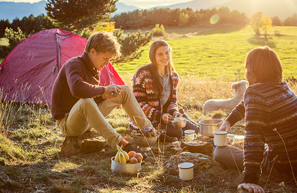 group of friends camping in fall autumn weating sweaters 1 jpg